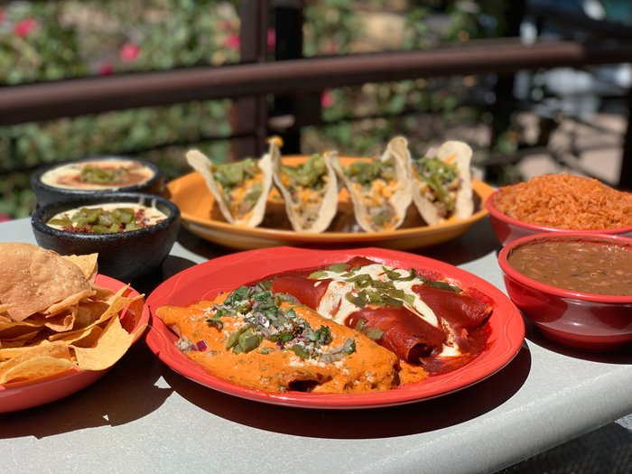 Jalapeno Inferno Mexican restaurant in Scottsdale and Peoria Arizona showing plates of enchiladas and tacos with mexican sides